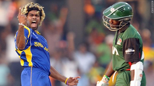 Sri Lankan bowler Lasith Malinga celebrates his hat-trick after dismissing Kenyan batsman Shem Ngoche.