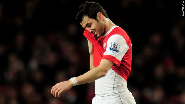 Arsenal captain Cesc Fabregas leaves the field with a hamstring injury during the game with Stoke.