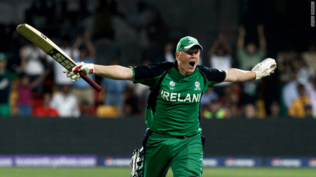 Kevin O'Brien celebrates scoring the fastest century in cricket World Cup history as Ireland stunned England in Bangalore.