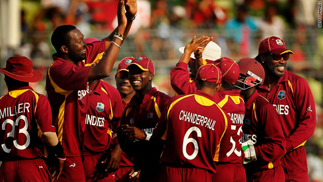 The West Indies celebrate a nine-wicket victory over co-hosts Bangladesh at the Cricket World Cup.