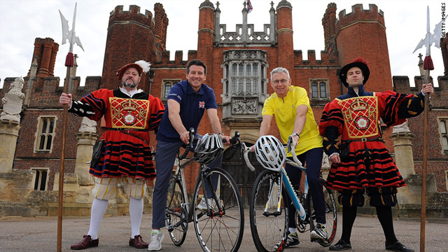 Sebastian Coe, left, poses on a bike in front of the historic Hampton Court Palace.