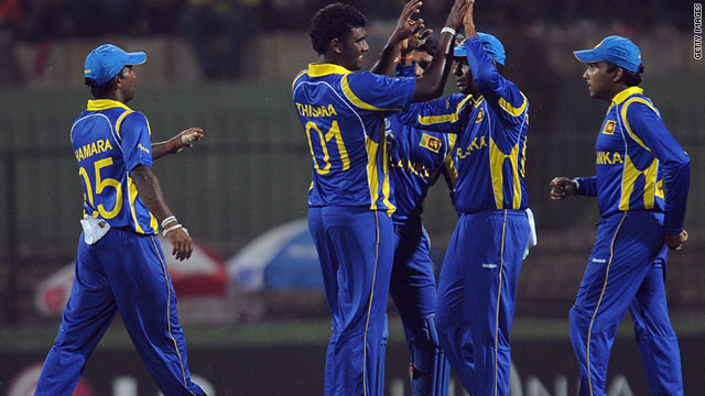 Sri Lanka's players celebrate reaching the 2011 Cricket World Cup quarterfinals with victory over Zimbabwe.