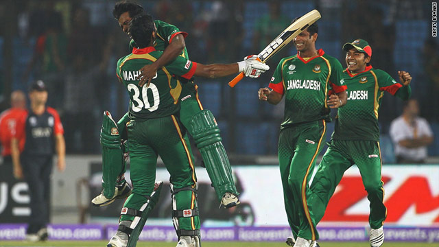 Bangladesh batsman Mahmudullah is mobbed by his teammates after hitting the winning runs against England.
