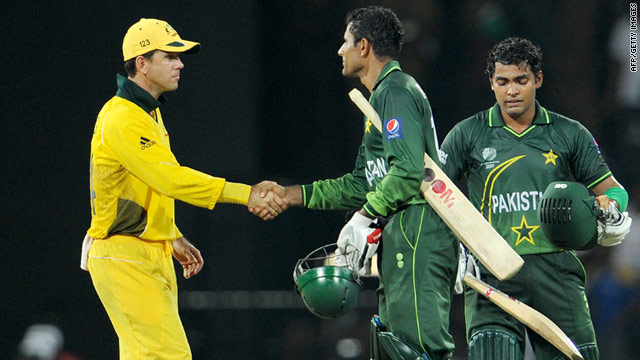 Australia captain Ricky Ponting, left, congratulates Pakistan batsmen Abdul Razzaq, center, and Umar Akmal.