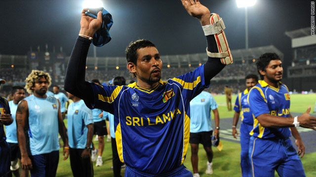 Tillakaratne Dilshan celebrates after Sri Lanka cruised into the cricket World Cup semifinals with victory over England.