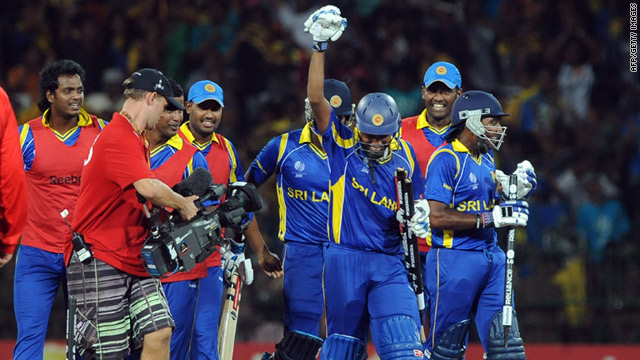 Sri Lankan players celebrate the five-wicket victory over New Zealand that secured a place in the World Cup final.