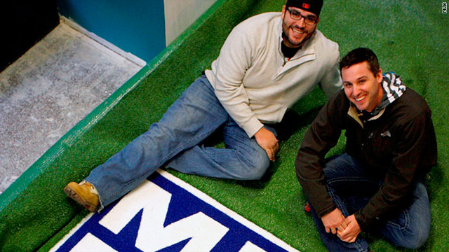 "Two baseball fans will watch 2,430 games in the new ""MLB Fan Cave"" in New York City."
