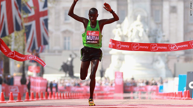 Emmanuel Mutai breaks the finish tape in central London as he ends the two-year title reign of fellow Kenyan Martin Lel.