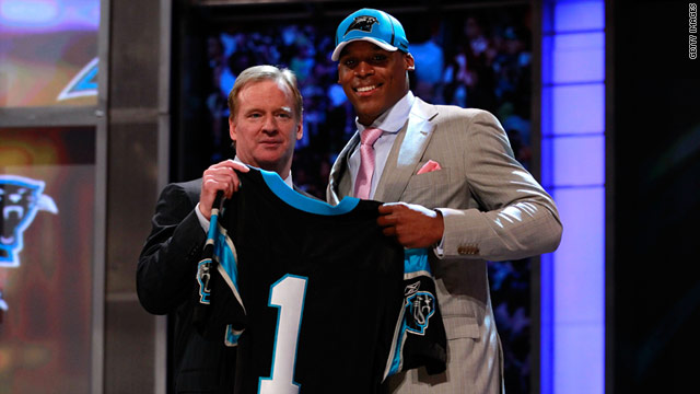 Cam Newton (right) poses with NFL commissioner Roger Goodell.