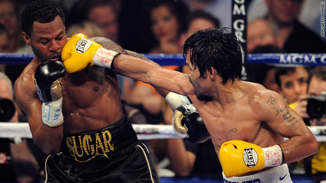 Manny Pacquiao of the Philippines throws a right at Shane Mosley in the WBO welterweight title fight at MGM Grand Garden Arena on Saturday in Las Vegas, Nevada.