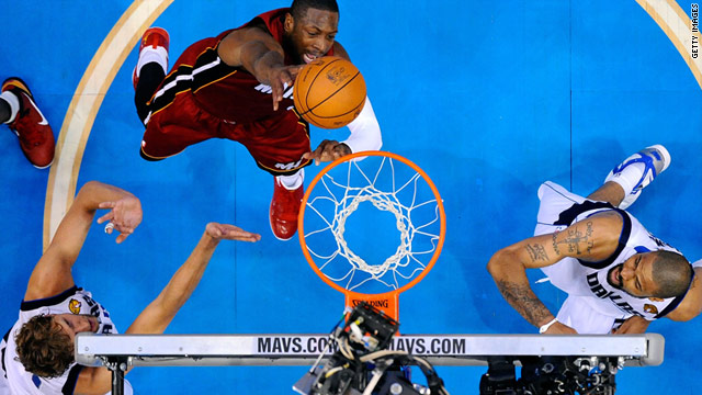 Dwyane Wade of the Miami Heat goes up to dunk the ball while taking on the Dallas Mavericks in Game Three.