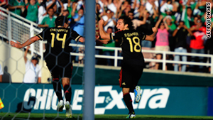 Andres Guardado, #18 of Mexico, celebrates his goal against the United States with Javier Hernandez, #14.