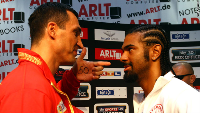 Klitschko (left) shows Haye (right) the number 50, after claiming the Briton will be the 50th knockout victim of his career.