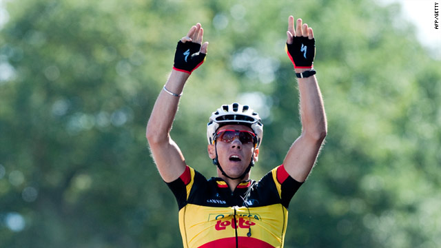 Philippe Gilbert raises his arms in triumph as he crosses the line to win the first stage of the Tour de France.