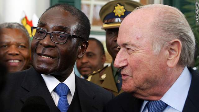 Zimbabwe President Robert Mugabe, left, stands beside FIFA President Sepp Blatter at State House in Harare on Monday.