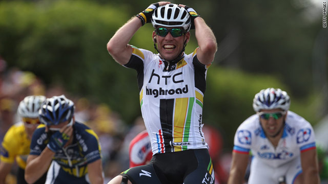 Mark Cavendish celebrates after winning a sprint finish to the seventh of 21 stages at the 2011 Tour de France.