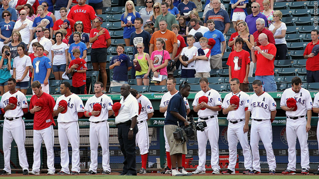 The Texas Rangers take a moment of silence on July 8, for Shannon Stone, a fan who died at a game last week.