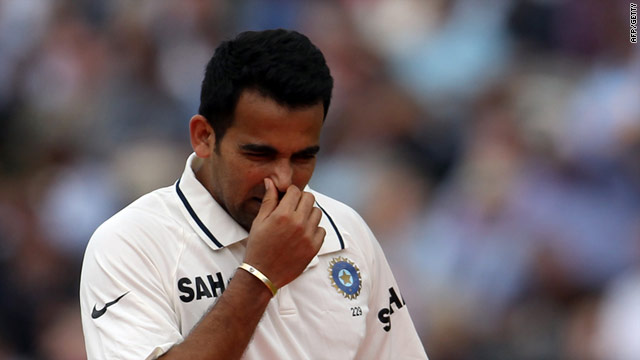 India's left-arm seamer Zaheer Khan limps off during the afternoon session at Lord's.