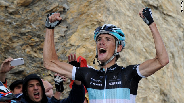 Andy Schleck crosses the line in triumph after his superb victory on the 18th stage of the Tour de France.