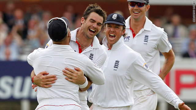 England bowler James Anderson celebrates after removing the key wicket of India's Suresh Raina