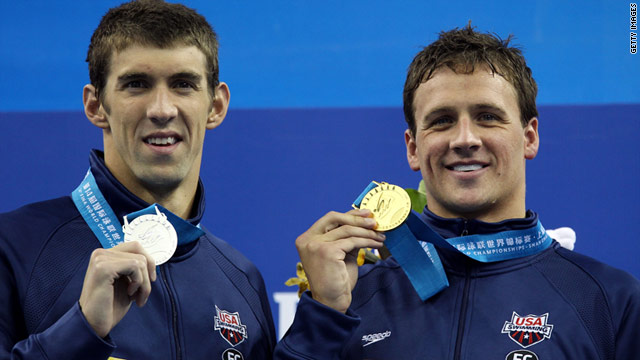 Michael Phelps (L) and Ryan Lochte pose with their medals in Shanghai.