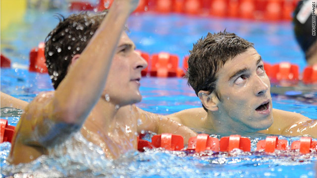 Ryan Lochte, left, celebrates his new world-record time while Michael Phelps watches in the pool in Shanghai.