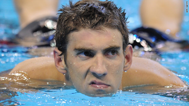 The effort shows on Michael Phelps' face after winning the 100m butterfly in Shanghai.