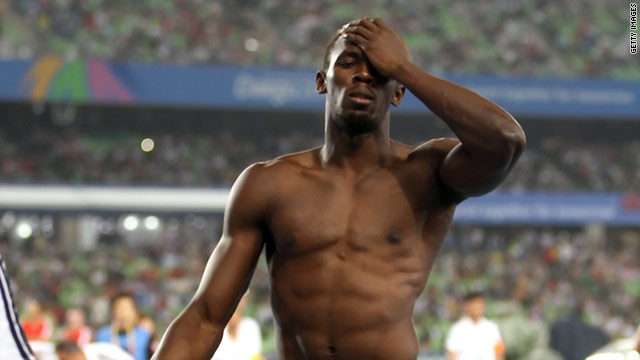 A disconsolate Usain Bolt walks away after his shock disqualification in the world 100m final.