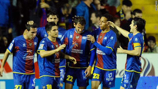 Levante players celebrate a goal against Real Madrid but they lost 8-2 on aggregate.