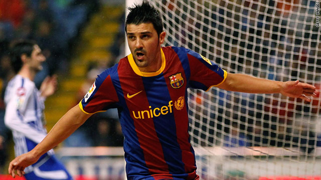 David Villa celebrates after scoring his 12th league goal this season for Barcelona and his 150th overall.