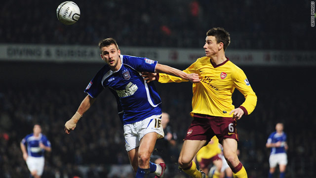 Ipswich hero Tamas Priskin, left, holds off a challenge from Arsenal defender Laurent Koscielny at Portman Road.
