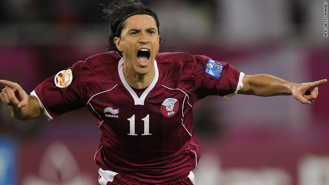 Fabio Cesar points the way towards the Asian Cup quarter finals after scoring Qatar's third goal in their match with Kuwait.