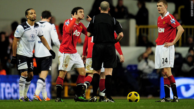 Rafael Da Silva sees red as referee Mike Dean gives him his marching orders after two yellow cards.