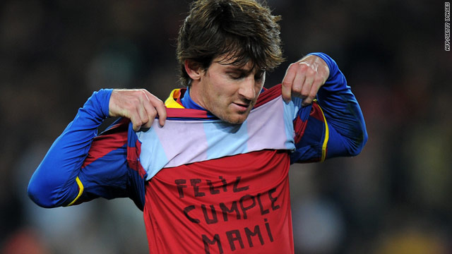 Messi celebrates his goal during Barca's victory over Rcaing, lifitng up his shirt to reveal a Happy Birthday message for his mum.