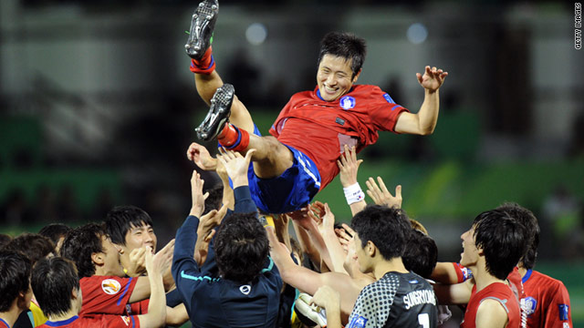 Lee Young-Pyo's South Korea teammates throw him into the air after they beat Uzbekistan.