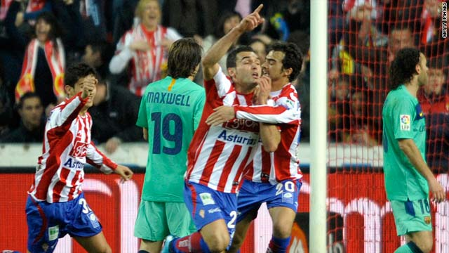 Sporting Gijon's David Barral celebrates after giving his side a shock lead on Saturday.