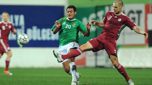 Latvia's Oskars Klava, right, vies for the ball with Jhasmany Campos of Bolivia during last week's friendly in Turkey.