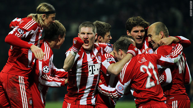 Bayern players celebrate the late goal for Mario Gomez in the San Siro.