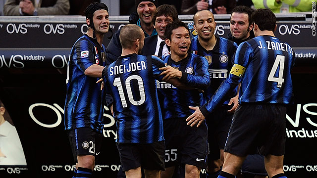 Inter players celebrate Yuto Nagatomo's first goal for the club in their 5-2 victory over Genoa.