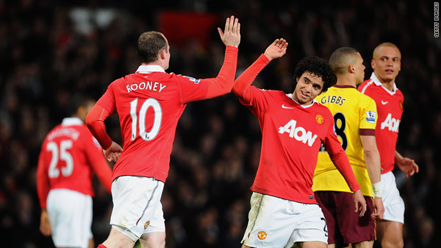 Wayne Rooney and Rafael da Silva celebrate his goal in the 2-0 win over Arsenal at Old Trafford.