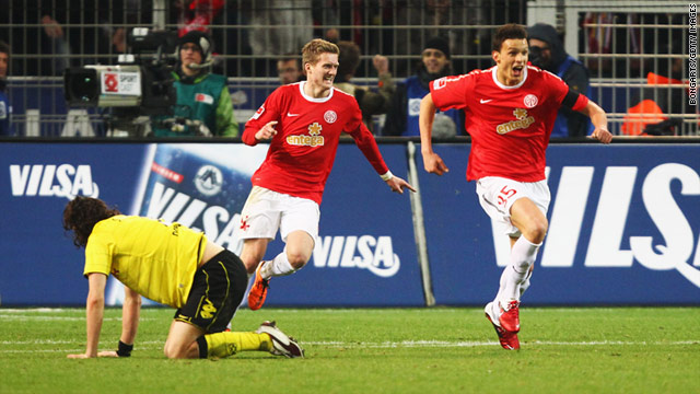 Mainz substitute Peter Sliskovic, right, celebrates after scoring his team's late equalizer against Borussia Dortmund.