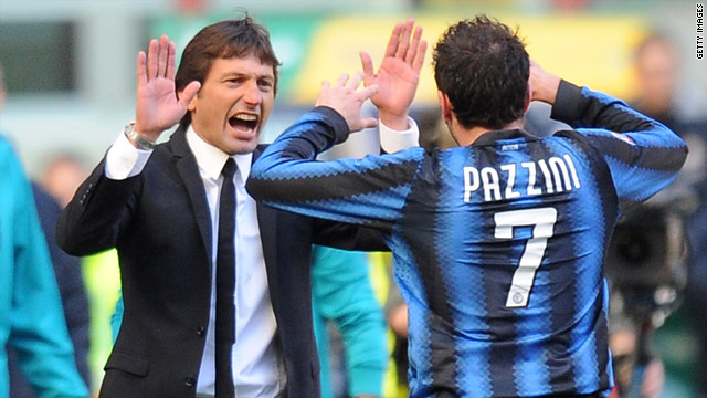 Striker Giampaolo Pazzini celebrates his winning goal against Lecce with Inter Milan coach Leonardo.