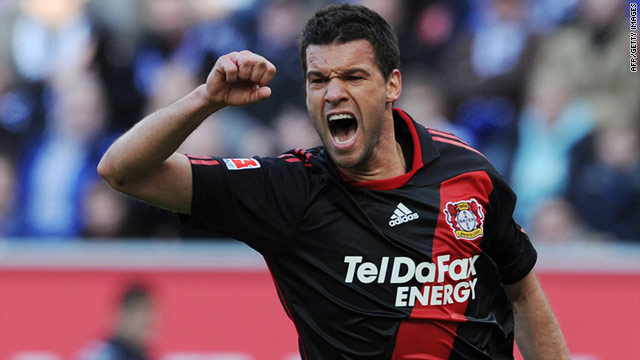 Michael Ballack celebrates Leverkusen's second goal after Schalke's Christoph Metzelder puts the ball into his own net.