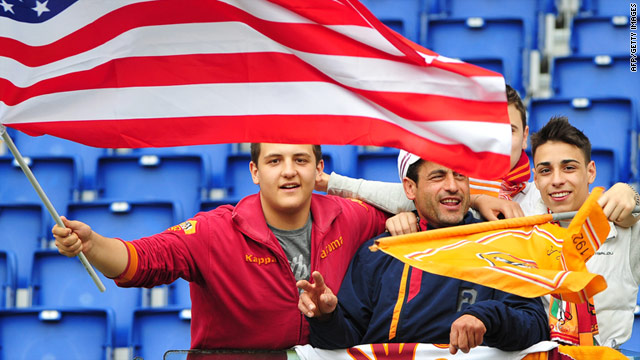 Roma fans fly a U.S. flag prior to Saturday's match against Palermo at the Stadio Olimpico in the Italian capital.