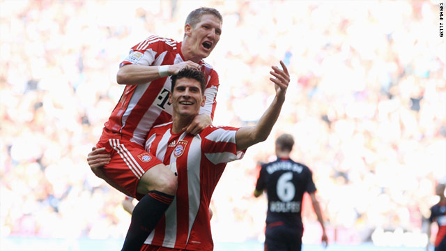 Bastian Schweinsteiger congratulates hat-trick hero Mario Gomez during Bayern's 5-1 win on Sunday.