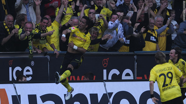 Argentinian striker Lucas Barrios celebrates Dortmund's opening goal in the 2-0 win over Nuremburg.