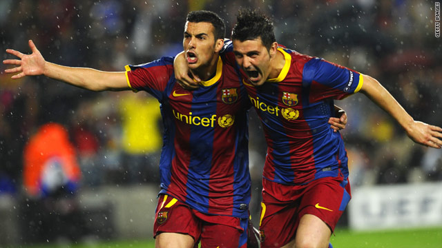 Pedro (left) celebrates with David Villa after scoring the crucial goal in the Nou Camp.
