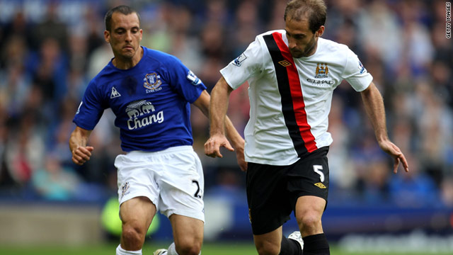 Pablo Zabaleta and Leon Osman (left) scrap for the ball during Everton's 2-1 win over Manchester City.