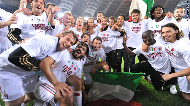 AC Milan players celebrate the club's first league title in seven seasons after they drew 0-0 at Roma on Saturday.