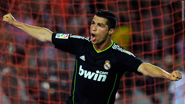 Cristiano Ronaldo celebrates one of his four goals scored in Real Madrid's 6-2 drubbing of Sevilla on Saturday.